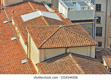 Red tile roof of a modern building. Top view.