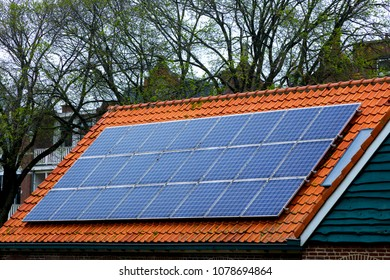 Red tile Roof with solar panels. New solar technologies on the old house.