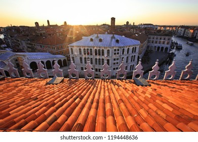 Red tile roof and sunset on Grand Canal, Venice, Italy