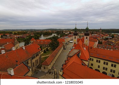 Red tile roofs in medieval city. Aerial view of Telc with main square and towers of the Church of the Holy Name of Jesus. A UNESCO World Heritage Site. Telc, Czech Republic