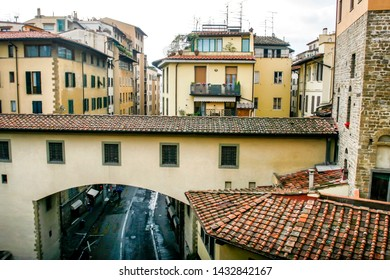 Red tile roofs of yellow Italian buildings in the old city in Florance, Tuscany, Italy. Rainy day, April 2012