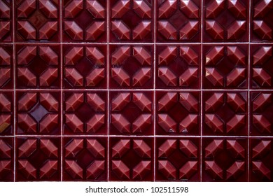 red tiles of the 70 forming a background