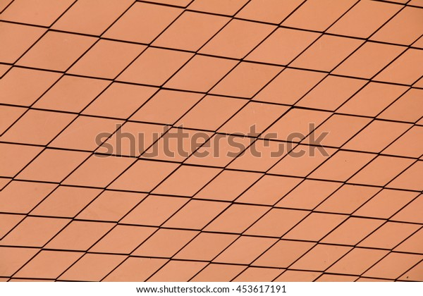 Red tiles roof background.