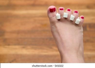red toenails freshly painted