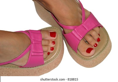 Red toenails and pink sandals.