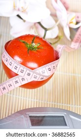 red tomato with pink measure