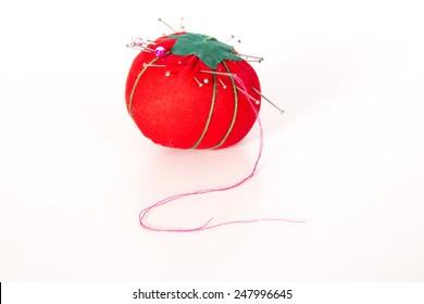 Red tomato shaped pin cushion