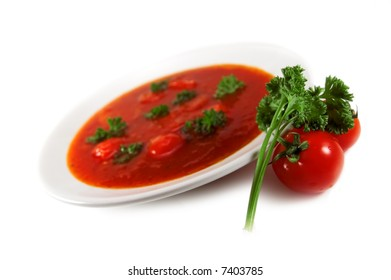 red tomato soup on white background