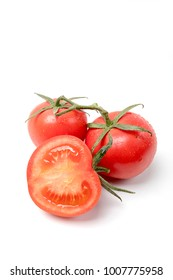 Red tomato vegetables are cut in white background