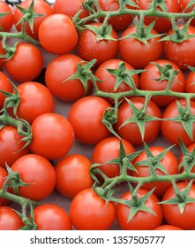 Red tomatoes background. Group of tomatoes. Full frame of cherry tomato on market.