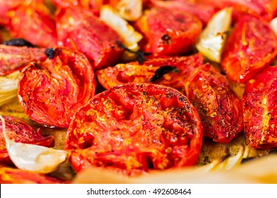 Red tomatoes baked with onions - the basis for tomato soup