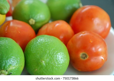 Red tomatoes and green limes