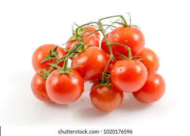 Red tomatoes isolated on white with a clipping path background.