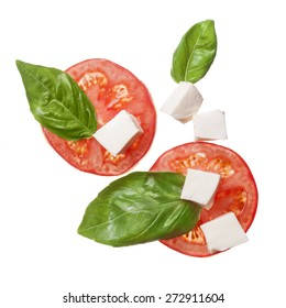 red tomatoes, mozzarella and basil isoalted on white - caprese, traditional italian ingrindients, top view