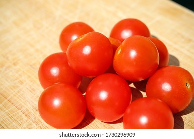 Red tomatoes on a wooden board