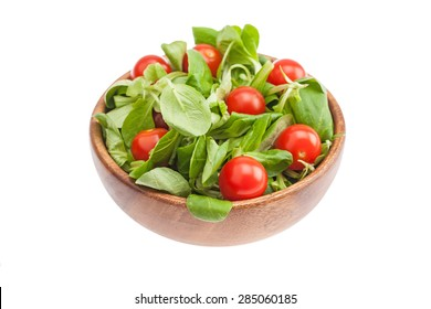 Red tomatoes in a plastick pack. Isolated, white background,