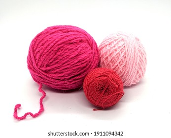 red tones of balls of thread. red tone balls of yarn on white background