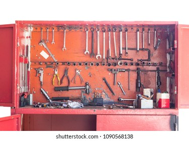 Red tool cabinet filled with technician equipment.At motorcycle repair shop.