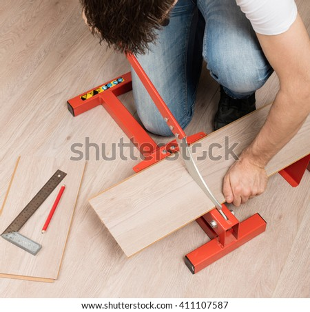 Red Tool Cutting Laminate On Laminate Stock Photo Edit Now