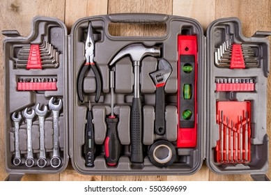 Red tools and black toolbox on the shop (store) showcase. Many wrench and nuts in toolkit sets