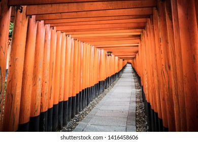 Red Tori Gate at Fushimi Inari Shrine in Kyoto, Japan. One of the largest tourist attractions in Japan