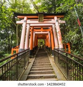 Red tori gate at Fushimi Inari Shrine in Kyoto, Japan. May 31 2019. It popular a path at Fushimi Inari.