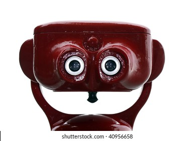 Red tourist binocular resembling a smiling robot face. Isolated on white.