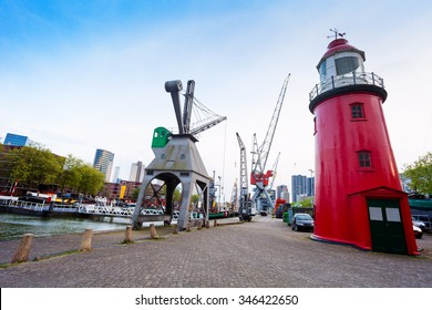 Red tower and Leuvehaven during day in Rotterdam