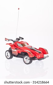 Red toy car on white background.