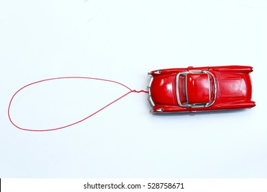 red toy car with talk bubble on white background. space for your message.
