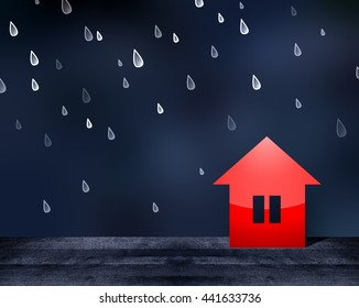 Red toy house in the cold rain. Dark blue blur background. Wooden surface. Large drops of rain falling. House needs to be protected from bad weather, dampness and rain. 3D illustration