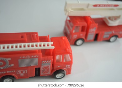 Red toys on white background