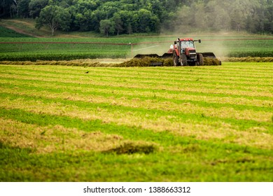Red Tractor working in field