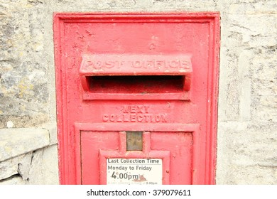 The red traditional classic postbox in the wall represent the postal concept related idea.