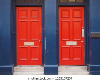 red traditional entrance door of a British house
