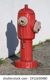 Red traditional fire hydrant on side walk, for fireman use