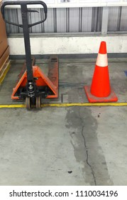 Red traffic cones,no parking hand lift in production line.