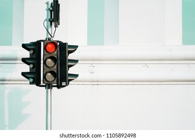 Red traffic light in the city street