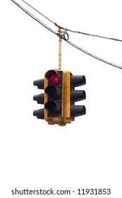 Red traffic light hanging from a cable, isolated on white