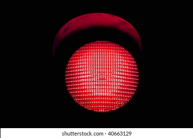 red traffic light, isolated on black background
