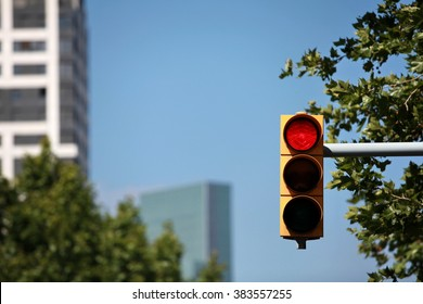red  traffic light on the background of the skyscraper