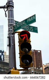Red traffic light on the intersection of Central Park South and Colombus Circus