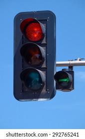 A red traffic light in Poznan