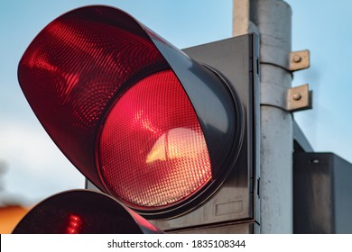 Red traffic light. Road signal for Intersection and control for transport. Standstill trafficlight on roadway in cloud background. Street stoplight safety urban concept. Colorful stop or warning sign