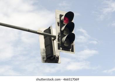 Red traffic lights against blue sky backgrounds.