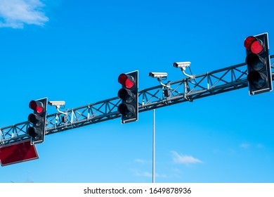 Red traffic lights and cameras against the blue sky on the highway in Istanbul, Turkey.