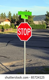 """Red traffic sign """"Stop"""" on the house background"""