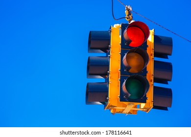 A red traffic signal with a sky blue background