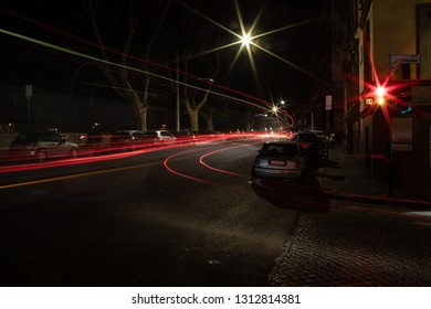Red trails of the traffic lights in Trastevere district, Rome, Italy. Long exposure shot.