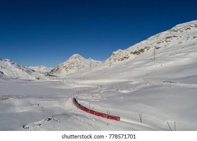 Red train of Bernina. Unesco heritage, Bernina express, winter landscape